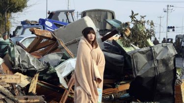 Reunited … Yuko Sugimoto searches for her son Raito in Ishinomaki.