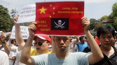Permitted protests: Vietnamese demonstrators hold anti-Chinese placards in Hanoi. The violence targeting factories thought to be Chinese-owned marks an escalation in the standoff.