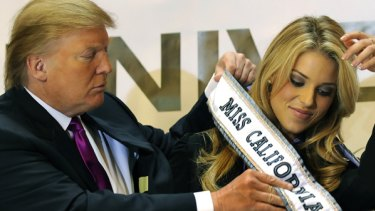 Still Miss California ... Donald Trump places a ribbon on Carrie Prejean.