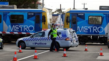 Police at the scene of the fatal strain strike at Moreland railway station.
