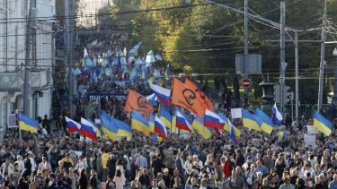 Tens of thousands of Russians marched through Moscow in protest at the Ukraine conflict.