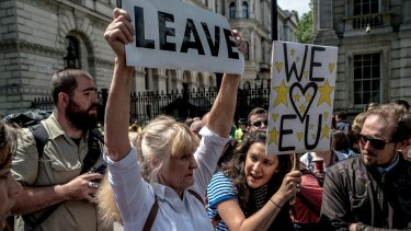 A 'Leave' campaigner and a supporter of 'Remain' during demonstrations over the Brexit vote in London
