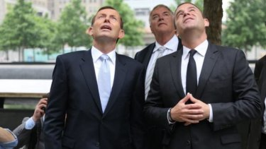 Prime Minister Tony Abbott looks up at the September 11 memorial in New York with memorial president Joe Daniels.
