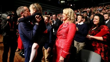 Opposition Leader Bill Shorten kisses Clementine during the ALP campaign launch.