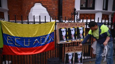 A supporter of WikiLeaks founder Julian Assange outside the Ecuadorian embassy in central London this week.