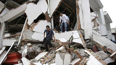 Lucky to be alive, students clamber from a collapsed building in Padang.