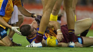 Heavy hits ... Jonathan Brown suffered multiple facial fractures in a heavy clash during round one.