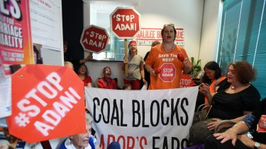 Protesters in Sydney make their views on Adani clear. The NAIF is considering a $1 billion loan to a company associated with Adani Group patriarch Gautam Adani.
