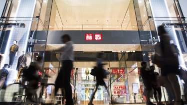 Uniqlo's sales are growing strongly thanks to new store openings but its profits are under pressure.