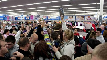 Crowds vie for cut-price video games.