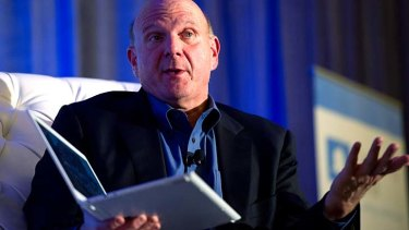 Microsoft CEO Steve Ballmer holds a Windows 8 Samsung laptop at an event earlier this month.