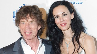 'We're still stupid'...Mick Jagger and US stylist Wren Scott arrive at the Cannes film festival overnight.