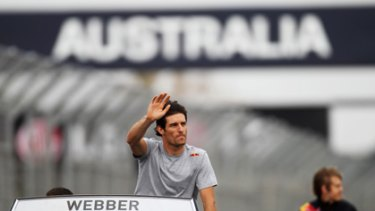 Mark Webber waves to the fans before today's race.