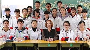 Class act: Julia Gillard visited year 11 students at Chenjinglun High School.