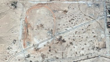 This October 26, 2014, satellite image provided by UNESCO shows levees and roads dug across the Northern Necropolis at Palmyra, Syria. IS fighters overran the historic town  in May 2015.