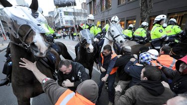Protesters reportedly punched and hit police horses as they advanced on the picket line.