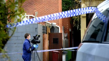 Police cordon off James Crawford's Albert Park townhouse.