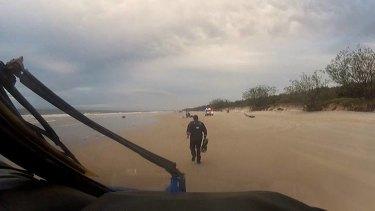 Emergency crews arrive at the scene of a paraglider crash on Bribie Island.