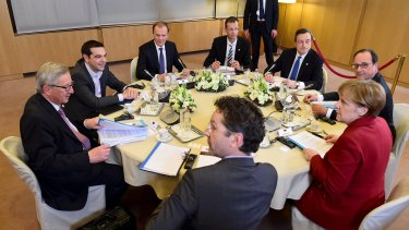 European Union leaders at a summit in Brussels on Thursday, with the still-tieless Greek Prime Minister Alexis Tsipras sitting across from German Chancellor Angela Merkel.