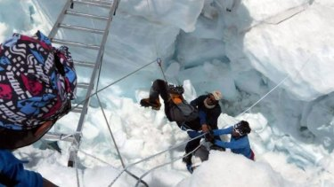 Nepalese rescue team members help a survivor of the April avalanche.