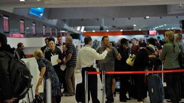 Stranded ... Qantas passengers try to make alternative arrangements.