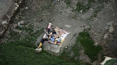 Pakistani flood survivors rest in an open area at the Kallam valley.