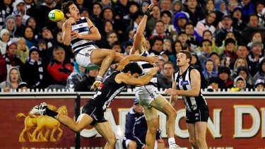 Geelong's Daniel Menzel takes a mark in the last quarter.