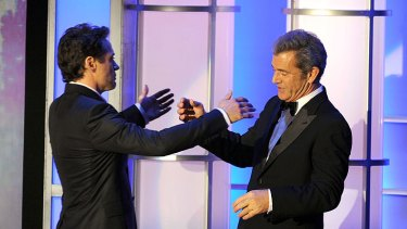 Mel Gibson presents Robert Downey Jr. with his American Cinematheque Award on Friday night.
