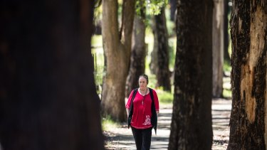 Lesley Bebbington walks among the trees around Kinglake.