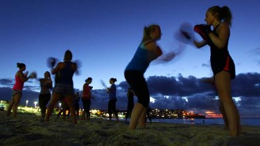 Training day: Bottoms Up! fitness groups exercise on Bondi Beach.