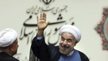 Iran's new President Hasan Rouhani waves after his swearing in at the parliament in Tehran.
