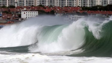A dangerous wave crashes over Haeundae Beach in Busan, South Korea, as Typhoon Neoguri approaches the Korean Peninsula.