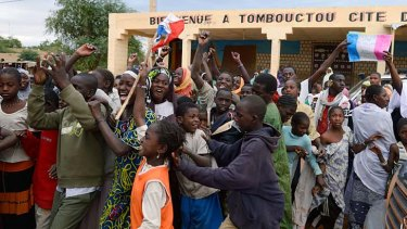 Joyous … residents welcome French and Malian troops after they entered Timbuktu, which had been occupied for 10 months by radical Islamists.