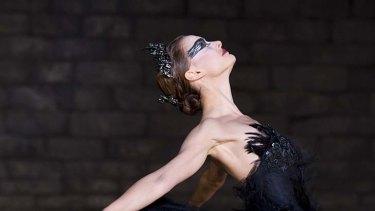 Actor Natalie Portman performs as a ballet dancer in Black Swan.