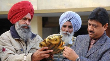 Indian wildlife officials   inspect a confiscated tiger skin in Amritsar last year.