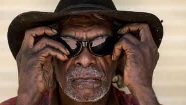 Jeffrey John of the Mulgin community wearing the glasses given to him by the Fred Hollows Foundation.