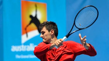 All about practice … Bernard Tomic goes through his paces at Melbourne Park before his first-round match.