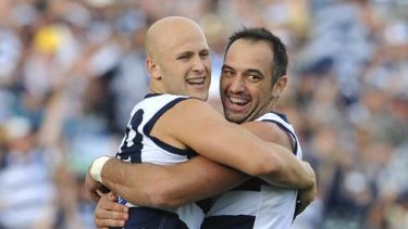 Gary Ablett celebrates a goal with new Cat cult figure James Podsiadly.