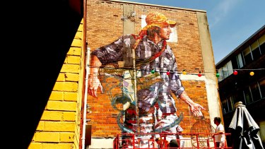 Street artist Fintan Magee's three-storey mural at the TWT Creative Precinct in St Leonards.