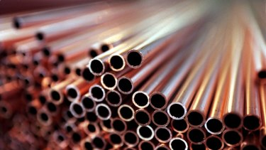 Copper tumbled as much as 8.7 per cent in London and fell to the daily trading limit in Shanghai.