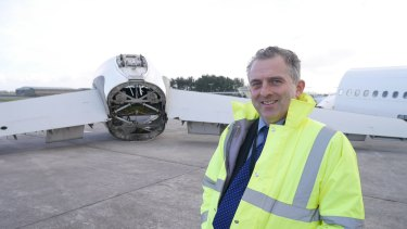Miles Carden, aerohub enterprise zone manager, poses in from of aeronautical equipment at Cornwall Airport, Newquay.