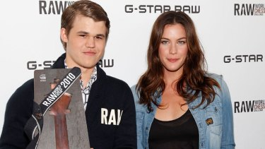 Making chess fashionable: Magnus Carlsen with actress Liv Tyler.