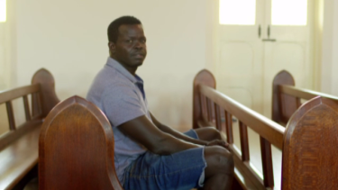 Ayik, pictured, was stunned to come across the man who tortured him.