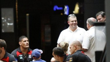 Newcastle Knights players with Hunter Sports Group owner Nathan Tinkler (standing).