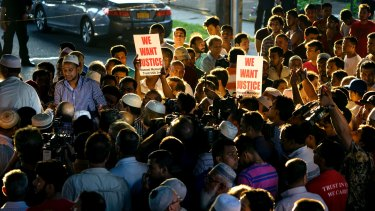 People demonstrate near the scene of the shooting in the Ozone Park neighbourhood of New York.
