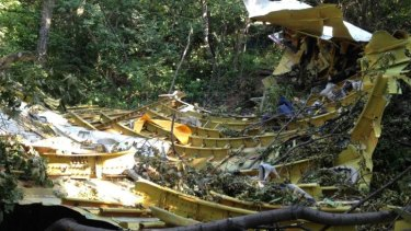 Inside the section of fuselage, peeled open in a dense thicket of trees.
