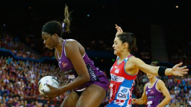 Intense rivalry: Firebirds star Romelda Aiken collides with Swifts defencer Sharni Layton during the 2016 ANZ Championship grand final between Queensland and NSW at Brisbane Entertainment Centre.