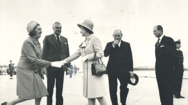 Playing her part ... Margaret Whitlam meets the Queen.