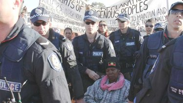 Traditional Owner Janet Cox being arrested this afternoon.