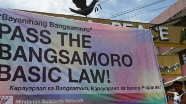 A banner supporting the passing of the law giving autonomy to Muslims on Mindanao.